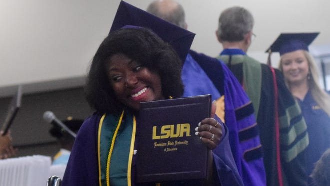 Aaliyah Boyd, poses with her bachelor's in business degree, after receiving it Thursday during LSUA commencement at the Alexandria Riverfront Center.