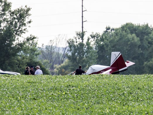 A downed small experimental plane July 30, 2013 in a field across W. Snell Road from the Oshkosh Correctional.