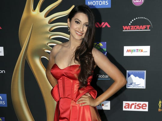 Indian actess and model Gauhar Khan poses for photographers as she walks the green carpet for 15th annual International Indian Film Awards Saturday, April 26, 2014, in Tampa, Fla.