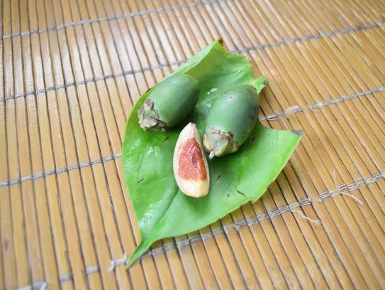 Betel nuts lie on a pupulu leaf.