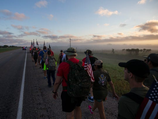 People march down U.S. Highway 77 for the Texas Ruckfest