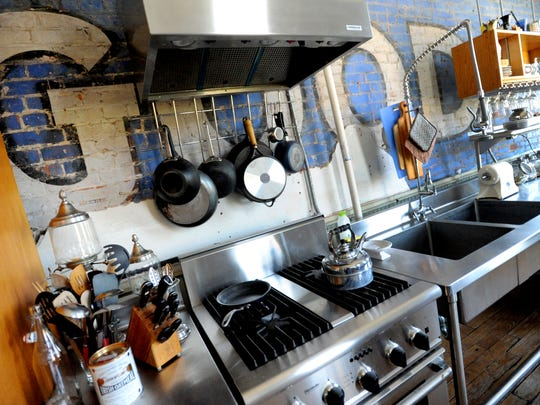 The kitchen of David Nelson's apartment has an industrial look.