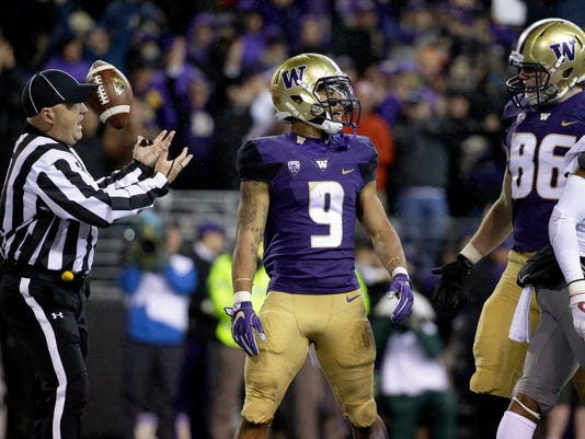 Washington running back Myles Gaskin (9) stands in the end zone after he scored his first touchdown in the first half of an NCAA college football game against Washington State, Saturday, Nov. 25, 2017, in Seattle. (AP Photo/Ted S. Warren)
