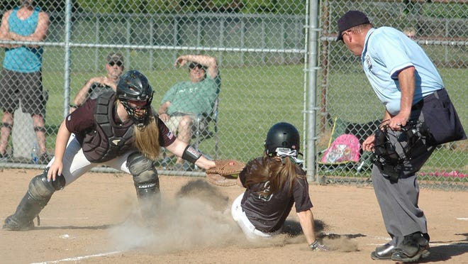 West Salem senior catcher Shelby Buchheit tags out a Tigard runner at home in the fourth inning of a Class 6A softball second round playoff game Wednesday at Tigard High School.