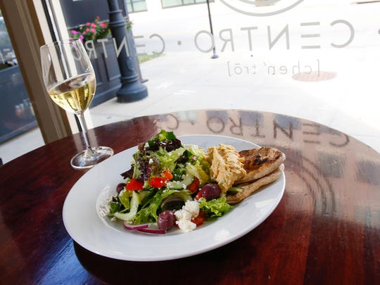 Greek salad and a glass of wine at Centro in downtown