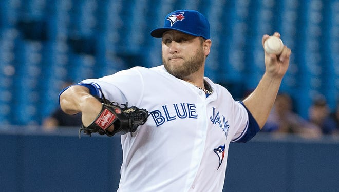 Blue Jays starting pitcher Mark Buehrle throws a pitch in the first inning in a game against the Rays at Rogers Centre.