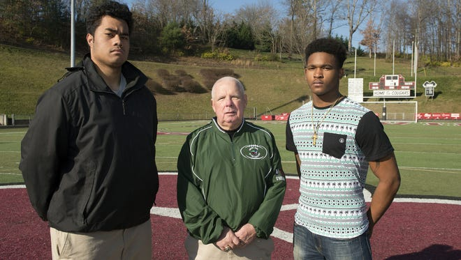 Asheville High assistant Charlie Metcalf coached in last year's Shrine Bowl of the Carolinas all-star game. He is pictured here with former Asheville standout Pete Leota, left, and Reynolds alum Rico Dowdle. They both played in the 2015 Shrine Bowl.
