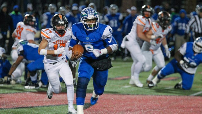Winton Woods' Kenny Mayberry takes the ball down the field during the WInton Woods vs. Anderson football game at Lakota West on Friday Nov. 10, 2017.