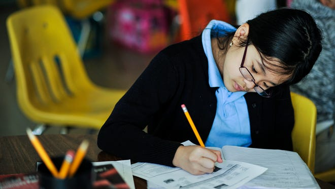 Any Linh Do, 10, works on testing skills with other fifth graders in her classroom at Rutherford Elementary School. Tuesday Nov. 25, 2014.