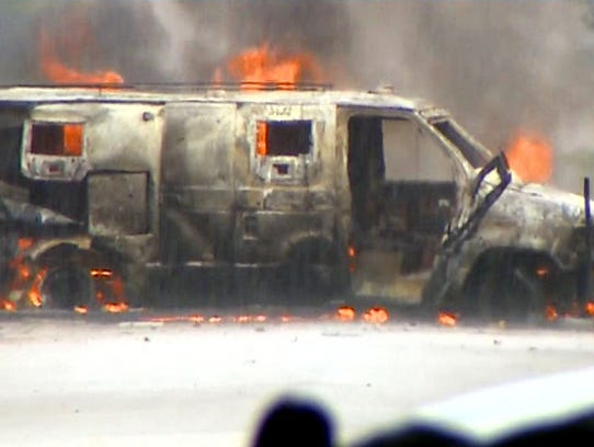 Dallas police were letting an armored van burn fearing