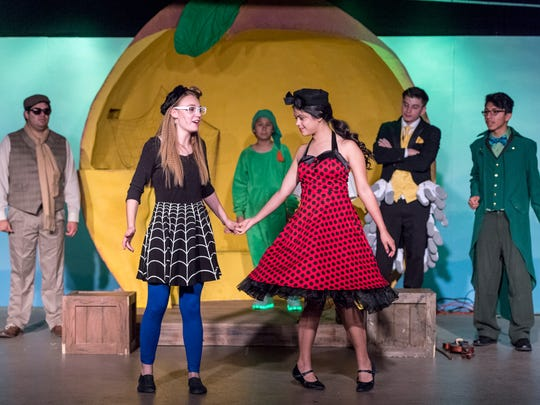 Zoe Roberts, left, and Jenna Smith rehearse for Encore Theater's production of James and the Giant Peach on Monday, June 25, 2018.