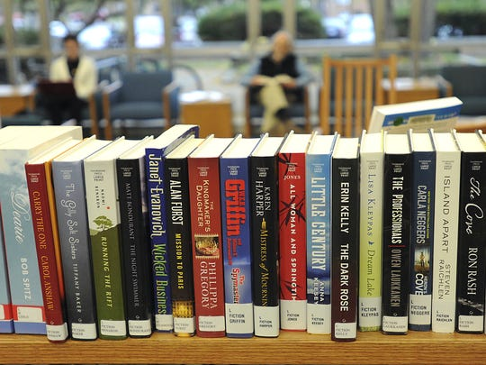 Books on a shelf at the East Lansing library