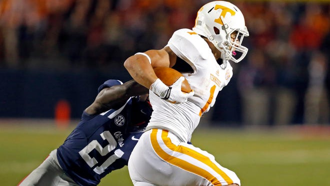 Tennessee running back Jalen Hurd (1) runs past a tackle attempt by Mississippi defensive back Senquez Golson (21).