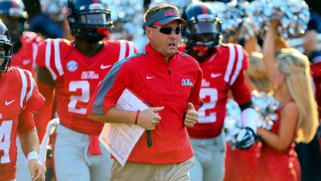Mississippi Rebels head coach Hugh Freeze leads the team to the field before the game against the Southeast Missouri State Redhawks at Vaught-Hemingway Stadium.