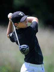 J.M. Butler of Trinity tees off during the 53rd Kentucky