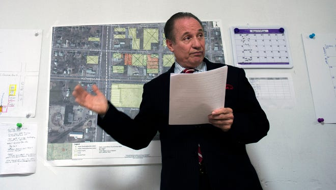 Mayor Ruben Bermudez speaks about the three-block radius around the contaminated Kil-Tone Co. waste site from inside the EPA's temporary Vineland office in May.