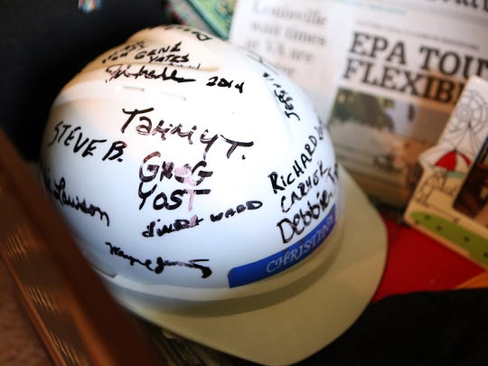 Ashley McMackin keeps a trunk of mementos, including a hardhat, to remind her of her mother.