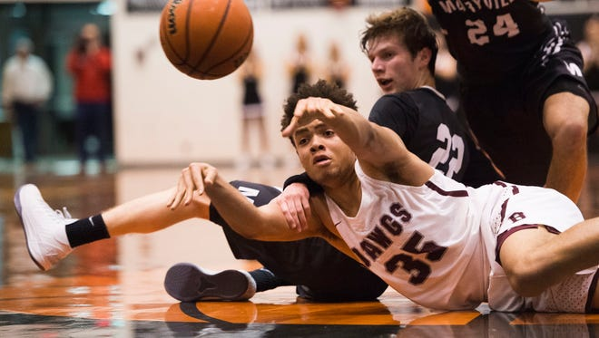 Bearden's Shamarcus Brown (35) passes the ball during a District 4AAA finals game between Maryville and Bearden at Lenoir City High School Tuesday, Feb. 20, 2018. Bearden defeated Maryville.