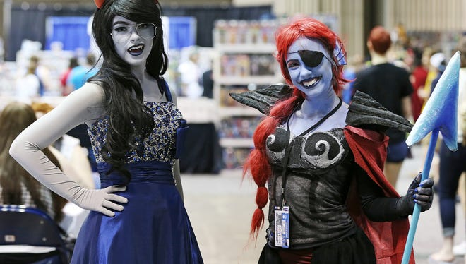 From left, Holly Lindsey, dressed as Briska from Homestuck, and Beth Polheber, dressed as Undyne from Undertale, during Pop Con at the Indiana Convention Center, Indianapolis, Friday, June 17, 2016.