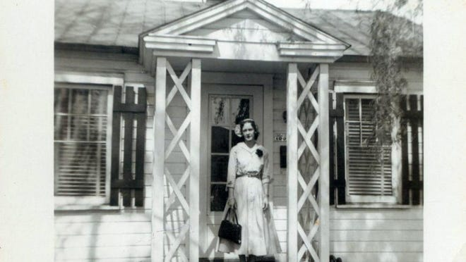 Susan McQuiston's mother Viola Bash stands in front of the family's house on Garfield Avenue in Lancaster. McQuiston's father Vince Bash built the house himself.