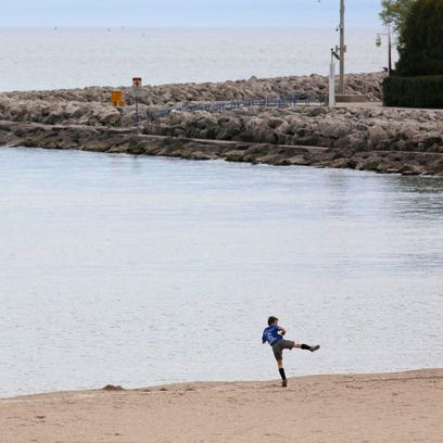 A youngster decides to kick off summer on the lakefront