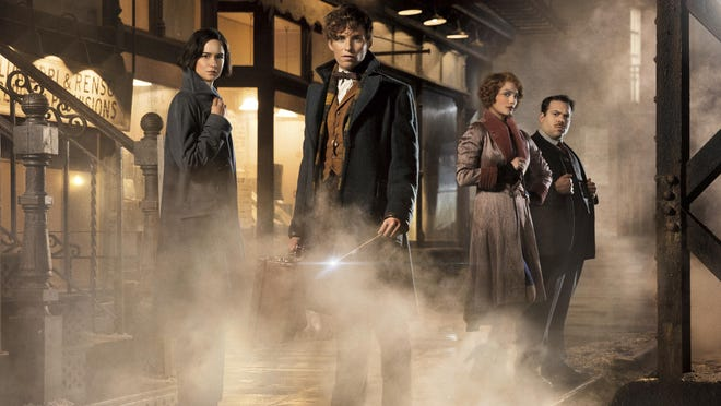 "This image released by Warner Bros. Pictures shows, from left, Katherine Waterston, Eddie Redmayne, Alison Sudol and Dan Folger in a scene from ""Fantastic Beasts and Where to Find Them."" At a fan event for the upcoming film in London on Thursday, Oct. 13, 2016, J.K. Rowling revealed that the budding franchise will now stretch to five films. The first, starring Eddie Redmayne, opens November 18. (Jaap Buitendijk/Warner Bros. Pictures via AP)"