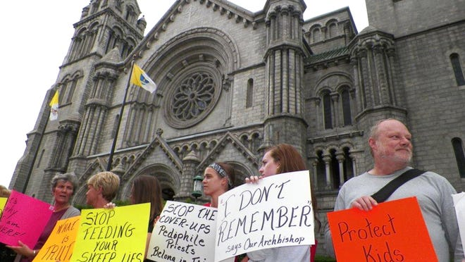 Protesters gather Wednesday outside the Cathedral Basilica in St. Louis to express concerns about the leadership of Archbishop Robert Carlson. The protest was organized by part by the Survivors Network of those Abused by Priests. The contends Carlson has failed to support victims of clergy abuse.