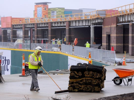 Work continues above the outfield walls at Cooley Law School Stadium on Wednesday.