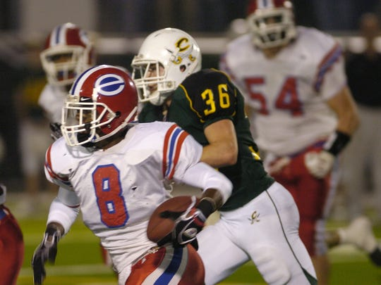 Evangel's Trey Wilson (8) returns an interception against Calvary during this 2007 meeting.