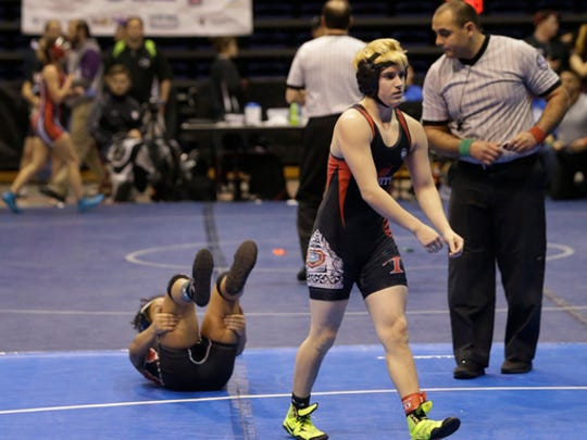 Mack Beggs, right, a transgender wrestler from Euless Trinity, is shown during a quarterfinal against Mya Engert of Amarillo Tascosa during the state wrestling tournament Friday, Feb. 24, 2017, in Cypress, Texas. Beggs was born a female and is transitioning to male but wrestles in the girls division.