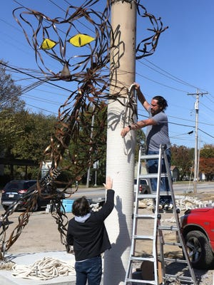 Jay Sheperd, bottom, helps Jesse Finwick, Jen's Kitty Rehab co-owner, wrap rope around a giant scratching post, Thursday, Nov. 5, as part of the Robbie Wellborn metal cat sculpture erected in front of the facility under construction across from Ramsey Junior High, 3123 Jenny Lind. Fenwick said that the scratching pole is 15-feet tall and the cat sculpture measures 24-feet from nose to tail. Jen's Kitty Rehab is scheduled for an early 2021 soft opening.