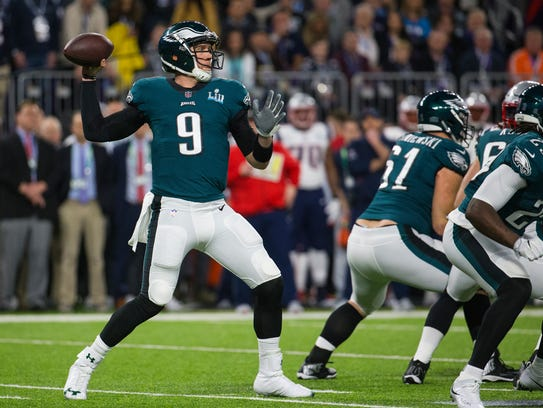 Eagles quarterback Nick Foles throws downfield Sunday