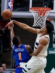 Milwaukee Bucks' Giannis Antetokounmpo blocks New York