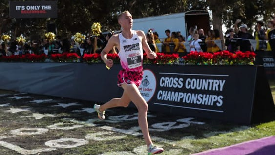 Chad Johnson crosses the finish line at the Foot Locker Cross Country Championships.