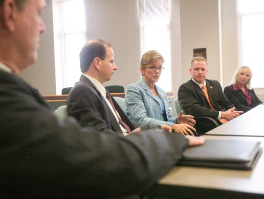 Gov. Jennifer Granholm (center) meets with area superintendents