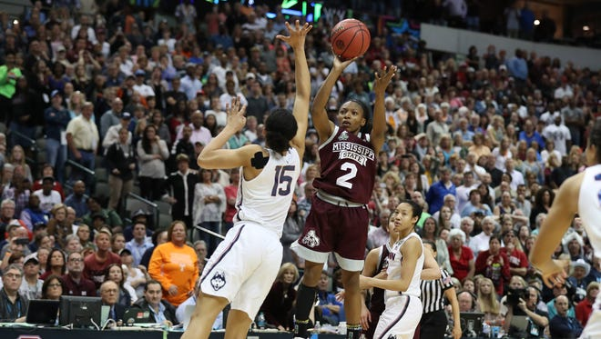 Mississippi State Bulldogs guard Morgan William hits the game winning shot in overtime against Connecticut.
