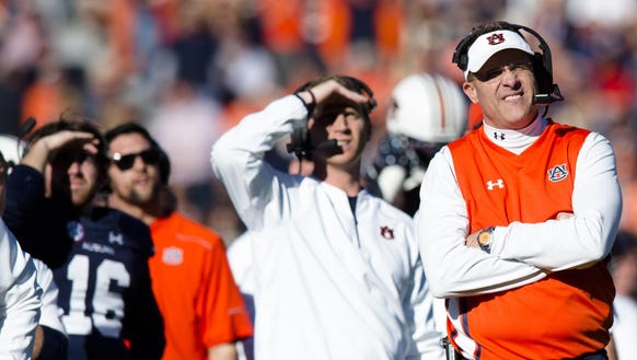 Auburn Tigers head coach Gus Malzahn looks on during