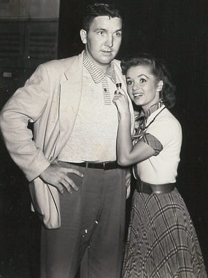 """Doctor-to-be Billy Trotter gets a personal examination from actress Debbie Reynolds in Dallas in the summer of 1953. """"She was a little 'ol thing,"""" he said of meeting the """"Singin' in the Rain"""" star."""