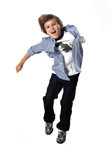 """Ben Clevenger, 6, first-grader at the Brown School  Son of Michael Clevenger, C-J staff photographer, and Tracy Oksendahl, design team leader  WHAT HE WORE: Gap checked shirt, $22.95; Dino t-shirt from Gymboree, $16:95; Gap jeans, $29.97, from the Gap at the Paddock Shops.  WHY: """"I chose this because it had a dinosaur on the shirt. And there was one that had about three hot dogs. And I really, really, really wanted a shirt with an astronaut on it. I will wear the handsome shirt (family-speak for the nice button-down over the T-shirt), as long as I have the dinosaur shirt under it.""""  MUST-HAVES: """"Shirts with pictures on them that I like."""""""