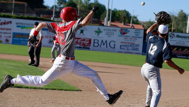 4-Corners' Gavin Mestas reaches first base ahead of the throw during a game against the Fuel on Thursday at Ricketts Park.