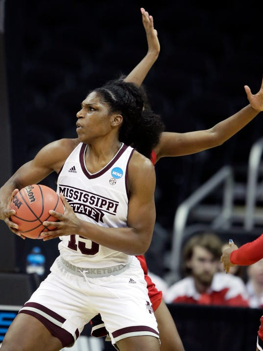 Mississippi State center Teaira McCowan (15) drives against North Carolina State forward Chelsea Nelson, back, during the first half of a women's NCAA college basketball tournament regional semifinal game, Friday, March 23, 2018, in Kansas City, Mo. (AP Photo/Orlin Wagner)