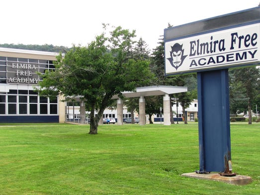 Elmira Free Academy will become a middle school in the fall, Ernie Davis Academy. Signs on the school exterior and lawn have not been changed yet.