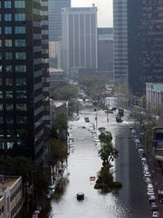 Downtown New Orleans flooded following Hurricane Katrina's hit and levee breaks.