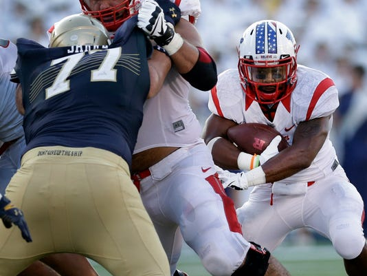 Rutgers running back Desmon Peoples, right, rushes the ball in the first half of an NCAA college football game against Navy in Annapolis, Md., Saturday, Sept. 20, 2014. (AP Photo/Patrick Semansky)