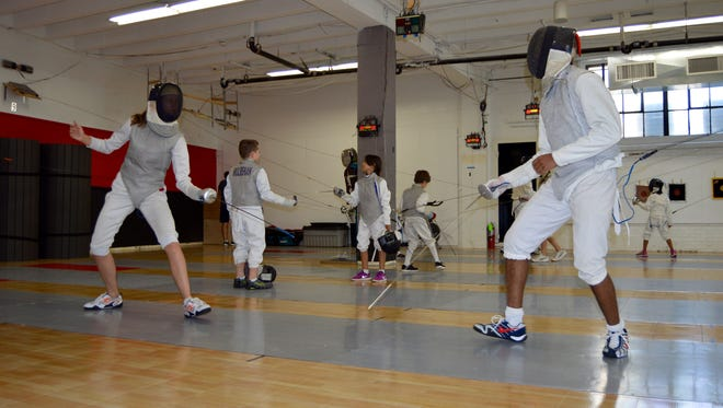 Solange Hybel (left) of Nyack, and Malcolm Jackson, of Valley Cottage, practice sparring at the Rockland Fencing Club