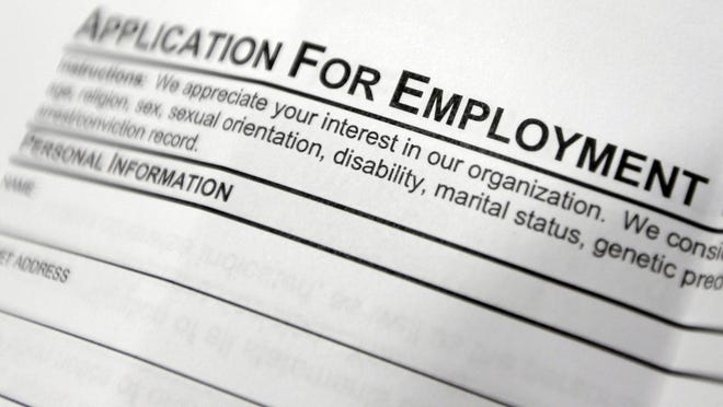 FILE - This April 22, 2014, file photo shows an employment application form on a table during a job fair at Columbia-Greene Community College in Hudson, N.Y. The Labor Department releases its weekly report on applications for unemployment benefits on Thursday, Feb. 4, 2016.