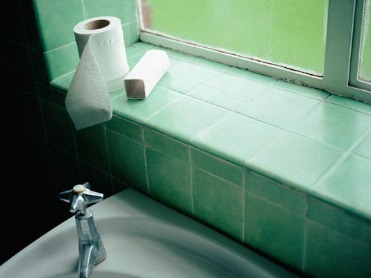 Toilet rolls on windowsill