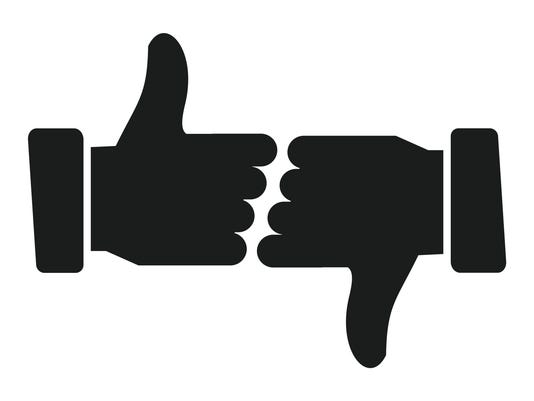 Hands showing thumbs up and down