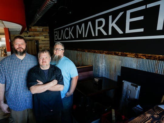 From left, Jason Delcour, Wesley Johnson and Scott Pitts opened Black Market Smokehouse.