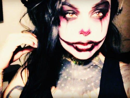 Nikki Sinn made up as a clown.
